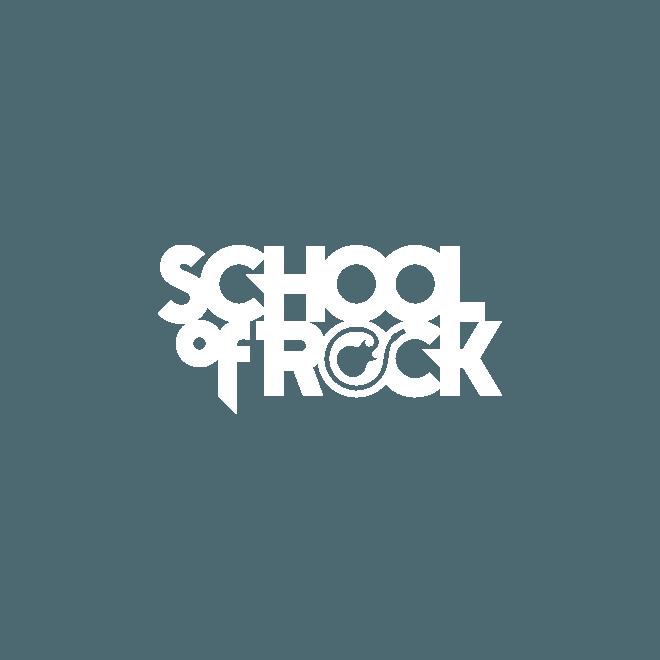 School of Rock attire un public local